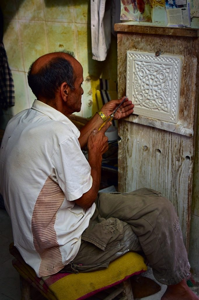 Picture of hand carving tiles in Marrakech Morocco